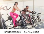 young happy couple in fitness... | Shutterstock . vector #627176555