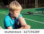 boy with a scraped knee outdoor.... | Shutterstock . vector #627196289