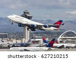 Small photo of Los Angeles, California, USA - March 10, 2010: Delta Air Lines Boeing 747 Jumbo Jet taking off from Los Angeles International Airport.