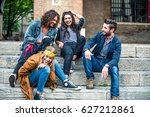 young friends sitting on... | Shutterstock . vector #627212861