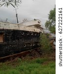 Small photo of a sad sight of old rusty abandoned ship.