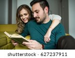 reading a book together | Shutterstock . vector #627237911