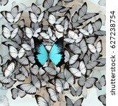 one big blue butterfly among a... | Shutterstock . vector #627238754