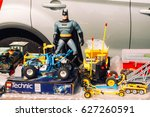 Small photo of FRANKFURT, GERMANY -AUGUST 23, 2015 : Closeup of Batman toy and Lego cars exposed in a haggle in Frankfurt.