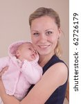 Happy mother with baby girl - stock photo