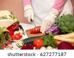 woman with gloves cutting... | Shutterstock . vector #627277187