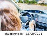 Woman Driving Car At Country...