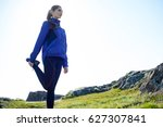 young fitness woman stretching... | Shutterstock . vector #627307841