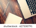 notepad  laptop and pen on wood ... | Shutterstock . vector #627330791