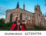 Woman Musician Playing The...