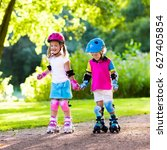 girl and boy learn to roller... | Shutterstock . vector #627405854