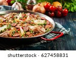 traditional paella with chicken ... | Shutterstock . vector #627458831