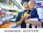 father and son are shopping in... | Shutterstock . vector #627471935