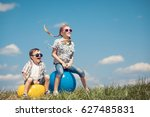brother and sister playing on... | Shutterstock . vector #627485831