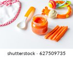 baby mashed with spoon in glass ... | Shutterstock . vector #627509735