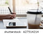 left handed woman writing on... | Shutterstock . vector #627514214