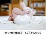 feet and legs of newborn baby... | Shutterstock . vector #627542999