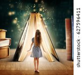 Small photo of Adventure story and fairy tale. Tiny girl and book with magic glowing on table