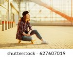 Young Hipster Woman Siting On...