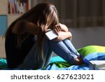 single sad teen holding a... | Shutterstock . vector #627623021
