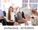 business trainer holding... | Shutterstock . vector #627628031