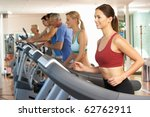 woman on running machine in gym | Shutterstock . vector #62762911