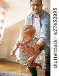 happy father playing with his... | Shutterstock . vector #627652895