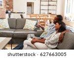 couple sit on sofa in open plan ...   Shutterstock . vector #627663005