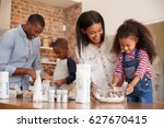 parents and children baking... | Shutterstock . vector #627670415