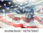 American flag blowing in the  wind and 100 dollars banknotes in the background. - stock photo