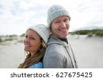 mature couple standing back to... | Shutterstock . vector #627675425