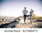 couple of runners training... | Shutterstock . vector #627680471