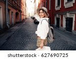 travel guide. young female... | Shutterstock . vector #627690725