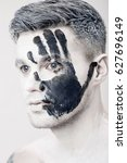 young man with black hand print ... | Shutterstock . vector #627696149