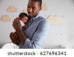 father holding newborn baby son ... | Shutterstock . vector #627696341