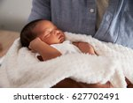 close up of father holding... | Shutterstock . vector #627702491