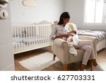 mother home from hospital with... | Shutterstock . vector #627703331