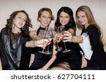 women clanging glasses and... | Shutterstock . vector #627704111