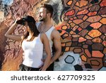 a young hiphop styled couple in ... | Shutterstock . vector #627709325