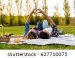 happy couple in love  lying on...   Shutterstock . vector #627710075