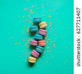 macaron dessert on a turquoise... | Shutterstock . vector #627711407