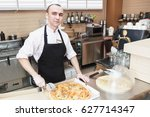 chef baker in uniform cutting... | Shutterstock . vector #627714347