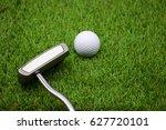 putter with golf balls on green ...   Shutterstock . vector #627720101