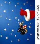 Small photo of Santa presents a present