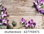 orchid flower on old wood... | Shutterstock . vector #627743471