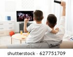 father and son watching... | Shutterstock . vector #627751709