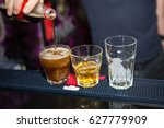 alcohol cocktail on the bar.... | Shutterstock . vector #627779909