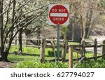 do not enter sign in a park | Shutterstock . vector #627794027