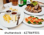 cheese served on plate with... | Shutterstock . vector #627869501