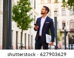 a handsome young businessman... | Shutterstock . vector #627903629